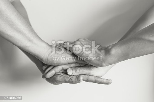 Stack of hands showing unity.