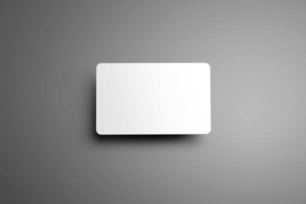 universelle leere mock-up einer bank (geschenk) karte mit schatten auf grauem hintergrund. - gutschein ausdrucken stock-fotos und bilder