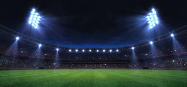 stade gazon universel éclairé par des spots et aire de jeux d'herbe verte vide - football photos et images de collection