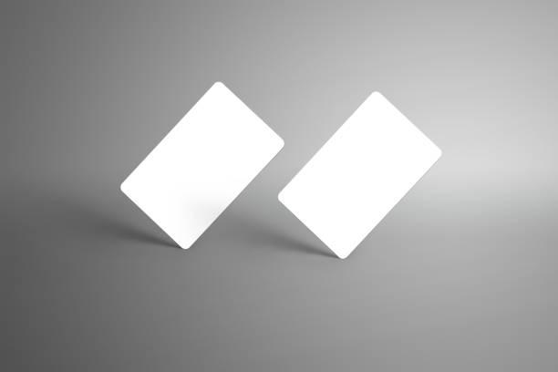 universal modell für zwei bank (geschenk) karten auf einem grauen hintergrund isoliert. - gutschein ausdrucken stock-fotos und bilder