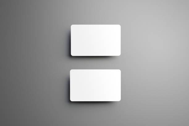 universal modell für ein zwei bankkarten (geschenk) auf grauem hintergrund. - gutschein ausdrucken stock-fotos und bilder