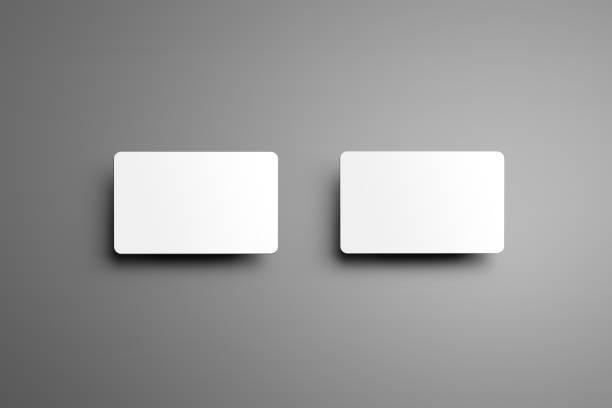 universal modell für ein zwei bank geschenkkarten mit schatten auf einem grauen hintergrund isoliert. - gutschein ausdrucken stock-fotos und bilder