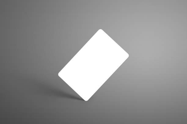 universal-mock-up einer bank (geschenk) karte auf einem grauen hintergrund stehend an der ecke mit schatten. - gutschein ausdrucken stock-fotos und bilder