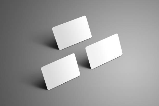 universelle vorlage von einem drei bank-geschenkkarten mit schatten auf einem grauen hintergrund. - gutschein ausdrucken stock-fotos und bilder