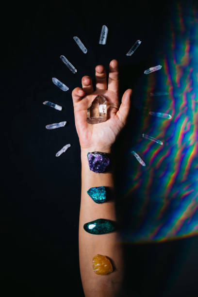 Universe within Hand with crystals crystal healing stock pictures, royalty-free photos & images