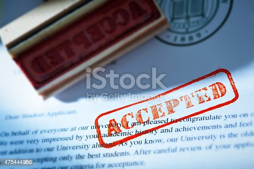 istock University Application Acceptance Notification Letter with ACCEPTED Stamp 475444986