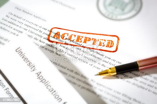 istock University Application Acceptance Notification Letter with ACCEPTED Stamp 476607882