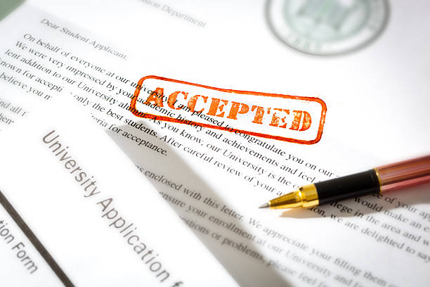 University Application Acceptance Notification Letter with ACCEPTED Stamp An acceptance letter from a university application. An university application form together with the letter of acceptance with a red rubber stamp of