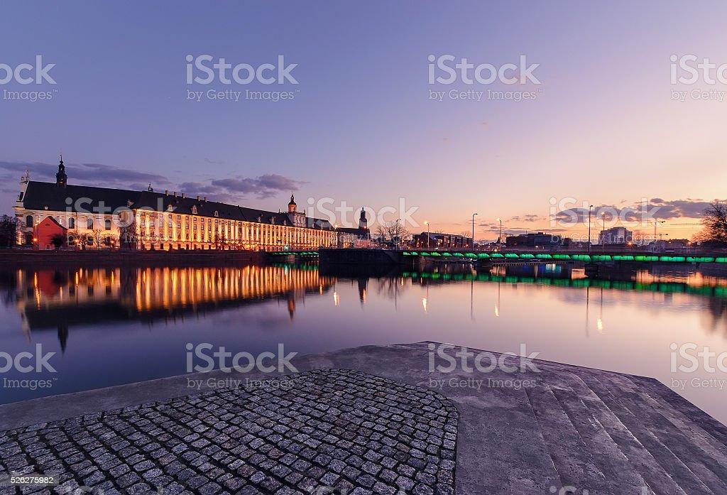 University bridge and Wroclaw university, in the evening. Poland. stock photo