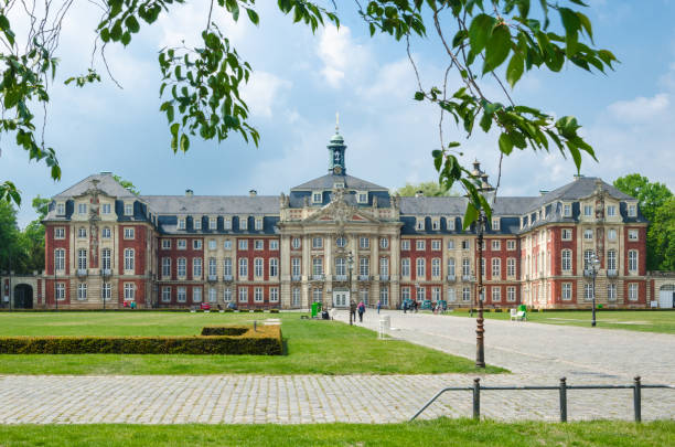 University building facade of Schloss Münster in North Rhine Westphalia, Germany with copy space stock photo