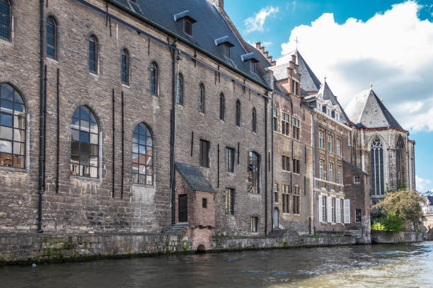 University building the property bordering Leie River, Ghent, Flanders, Belgium. stock photo