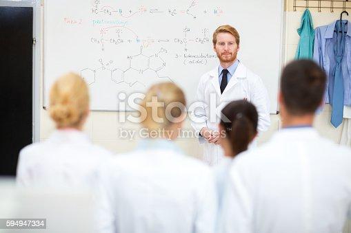 istock University chemistry professor studying his students 594947334