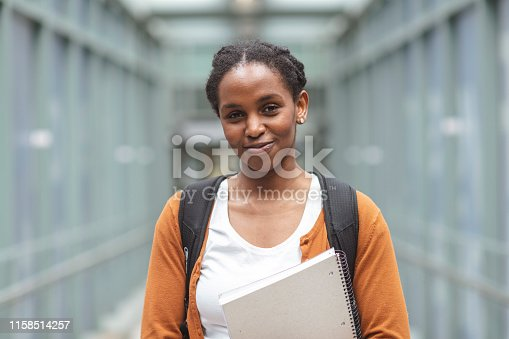 1009493672istockphoto University Female Posing 1158514257