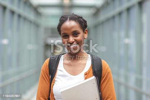 1009493672istockphoto University Female Posing 1164032901