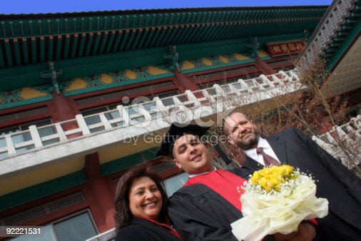 istock University graduate with his parents 92221531