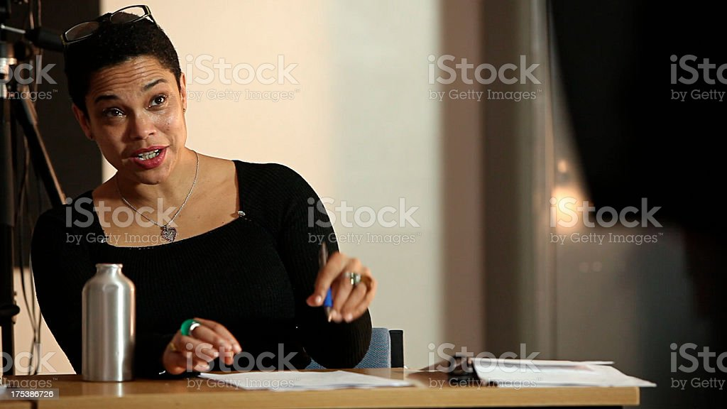 University lecturer talking to student royalty-free stock photo