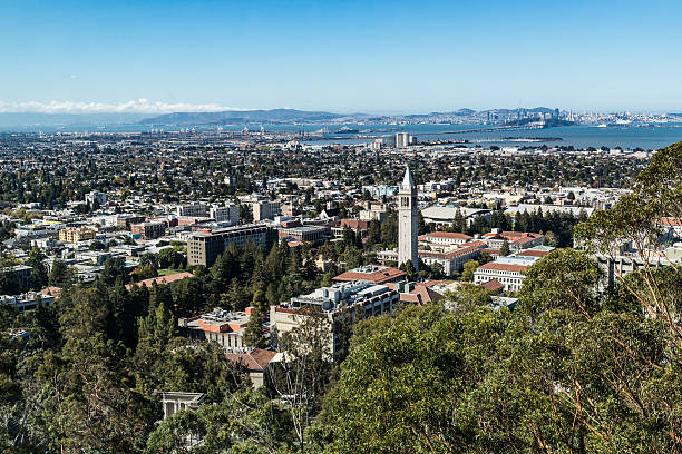 University of California Berkeley A view of UC Berkeley from Lawrence Berkeley Lab.   Sather tower, a campanile, is clearly visible near center.  The Bay Bridge and San Francisco are visible in the background. bell tower tower stock pictures, royalty-free photos & images