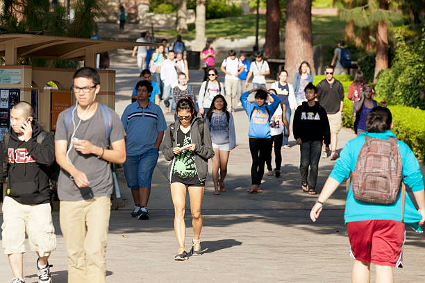 University of California, Los Angeles Los Angeles, California, USA - June 13, 2012. The location is University of California, Los Angeles. Large group of students walking about at the University campus. ucla stock pictures, royalty-free photos & images