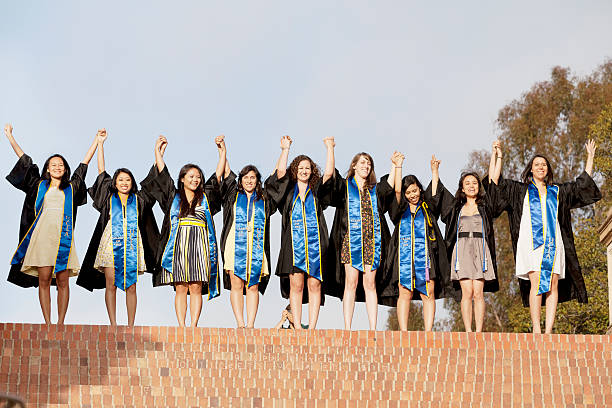 University of California, Los Angeles Los Angeles, California, USA - June 13, 2012. The location is University of California, Los Angeles. Groups of student posing for their post graduation photo. Their photographer to the right of where this camera is. ucla stock pictures, royalty-free photos & images