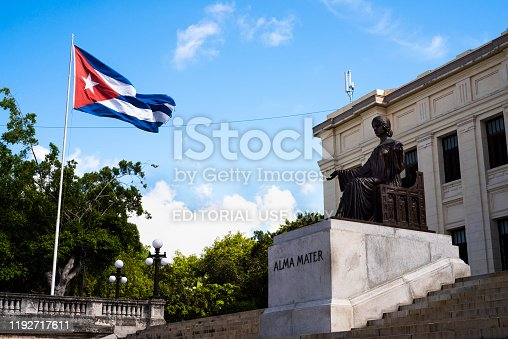 Havana, Cuba - 02 July 2019: University of Havana with Alma Mater sculpture and Cuban Flag, in the Vedado district of the city