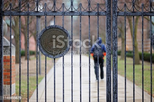 Champaign, Illinois, USA - April 4, 2019: University of Illinois crest on sidewalk gate located at the intersection of Matthews Avenue and Clark Street on the campus of the University of Illinois at Urbana-Champaign, Illinois.