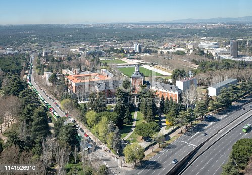 University of Madrid building in Madrid, Spain, with surrounding roads, playing fields and wider city