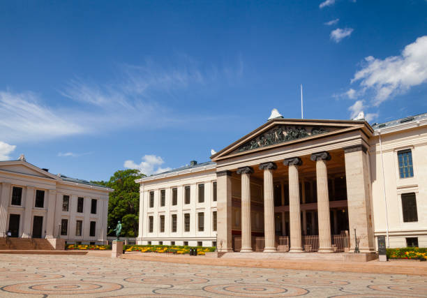 """University of Oslo Faculty of Law facade Central Oslo Norway Scandinavia OSLO, NORWAY - JULY 12, 2018: Universitetsplassen (University Square) with neoclassical building of University of Oslo Faculty of Law (Domus Media), known as a venue for the Nobel Peace Prize ceremony in 1947""""u20131989 university of oslo stock pictures, royalty-free photos & images"""
