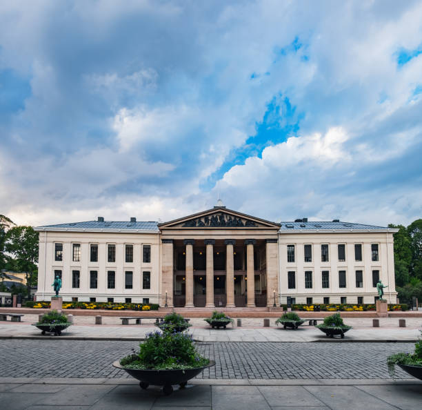 University of Oslo in Norway Universitetsplassen square under blue cloudy sky in Oslo, Norway university of oslo stock pictures, royalty-free photos & images