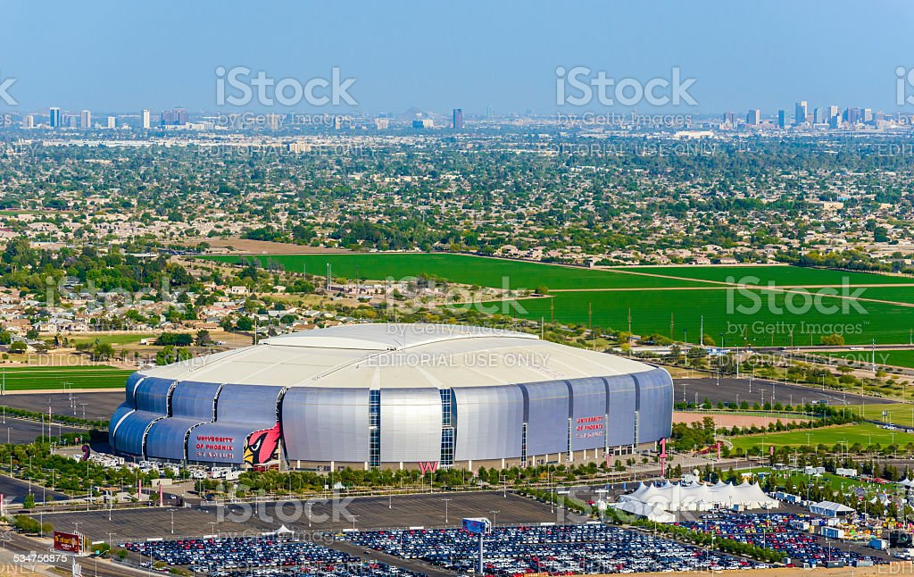 University of Phoenix Stadium Glendale Arizona, 2015 Superbowl football host Glendale, Arizona, USA - April 23, 2014: University of Phoenix Stadium in Glendale Arizona, with Phoenix Arizona skyline in distance on horizon, 2015 Stock Photo