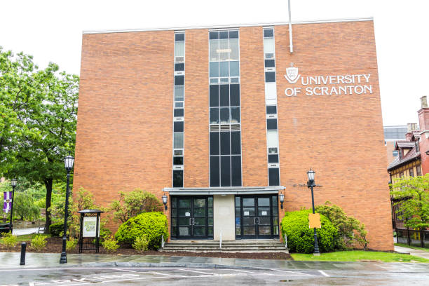 university of scranton brick building with sign and entrance - scranton pa stock photos and pictures