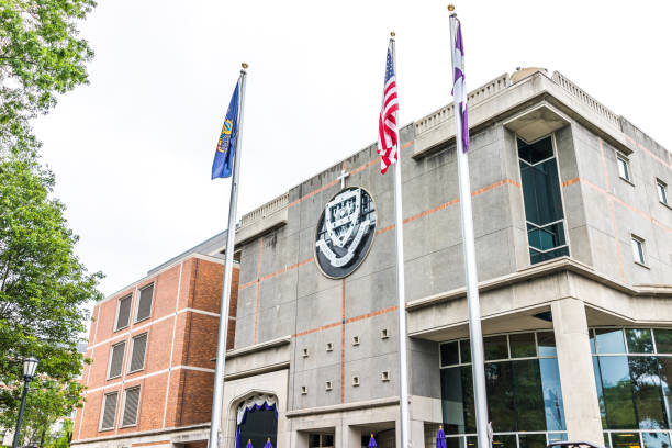 university of scranton library building with sign and entrance and flags - scranton pa stock photos and pictures