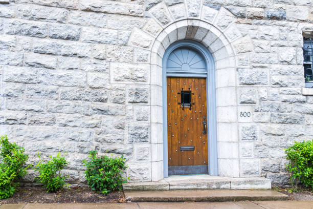 university of scranton office of undergraduate admissions entrance at 800 linden st with stone wall and wooden door - scranton pa stock photos and pictures