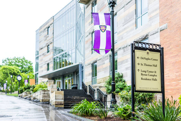 university of scranton purple flag and building with sign stating directions - scranton pa stock photos and pictures