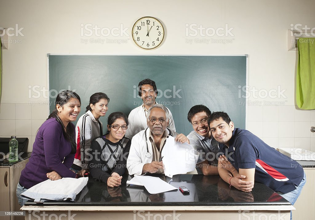 University Professor with his students stock photo