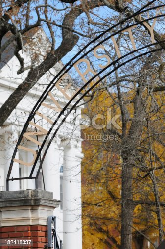 istock University sign with tree and building background 182418337