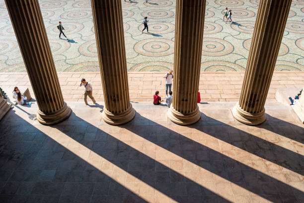University Square on University of Oslo central campus in Oslo Norway Students relax on University Square on the University of Oslo central campus in downtown Oslo Norway on a sunny day. university of oslo stock pictures, royalty-free photos & images