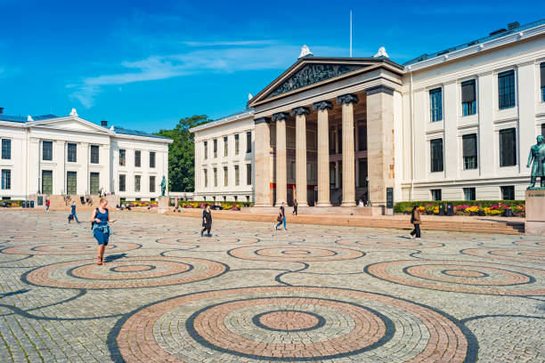 University Square on University of Oslo central campus Norway Students walk on University Square on the University of Oslo central campus in downtown Oslo Norway on a sunny morning. university of oslo stock pictures, royalty-free photos & images