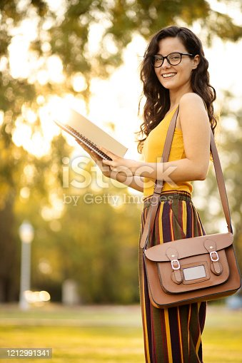 521911045 istock photo University student at a public park 1212991341