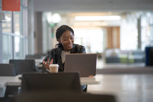 University student at work during COVID-19 stock photo