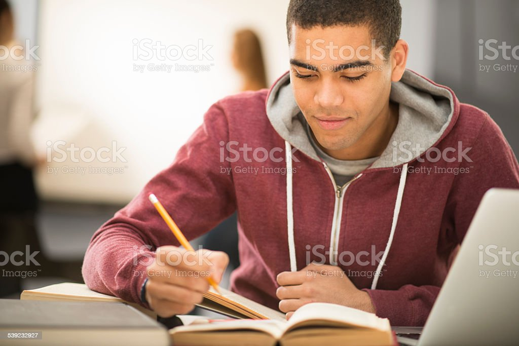 university student checking his notes stock photo