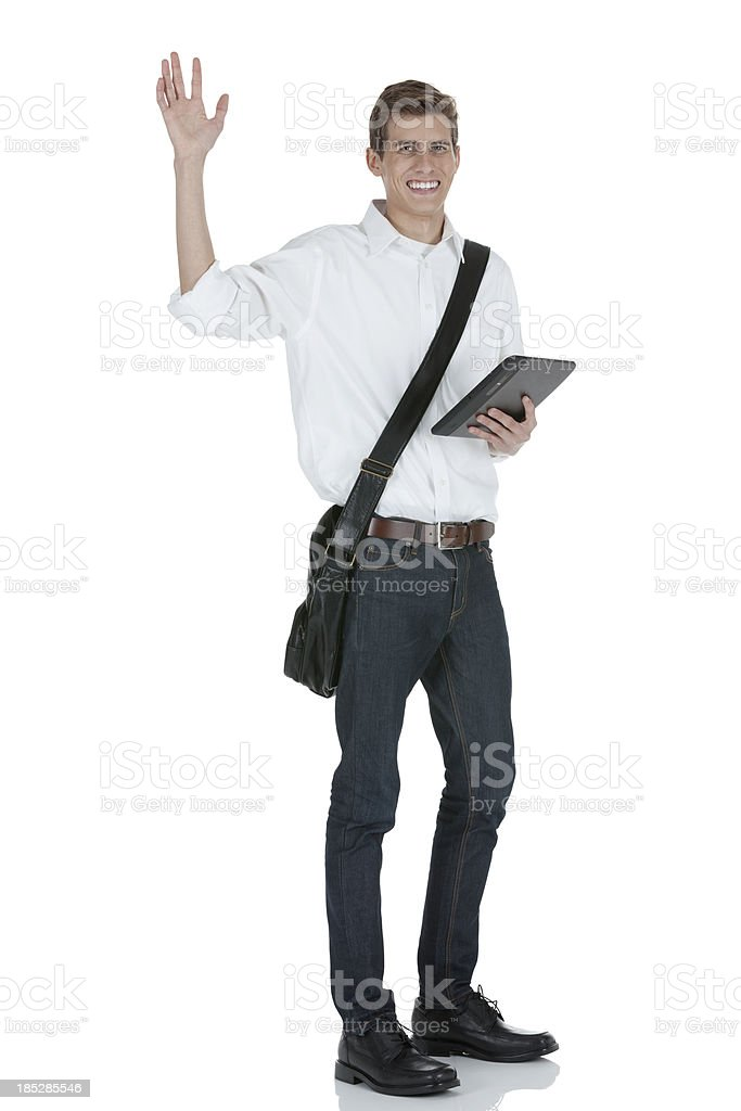 University student holding a digital tablet and waving hand stock photo