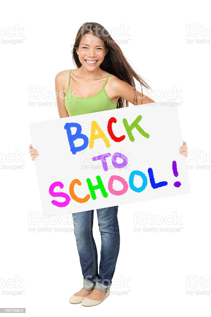 University student holding back to school sign royalty-free stock photo