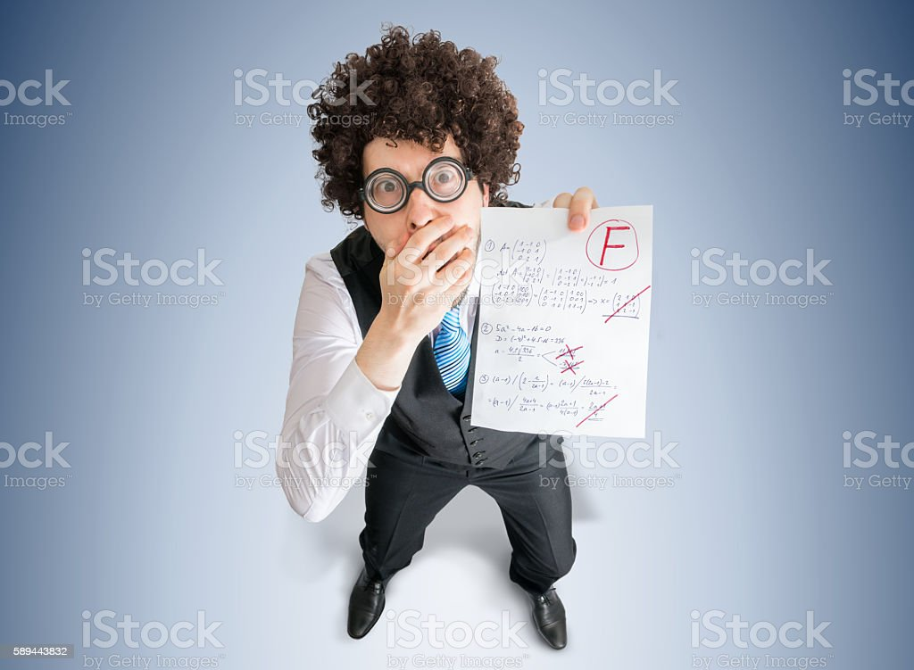 University student is disappointed from test results. stock photo
