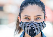 istock University student outside with a mask 1255809087