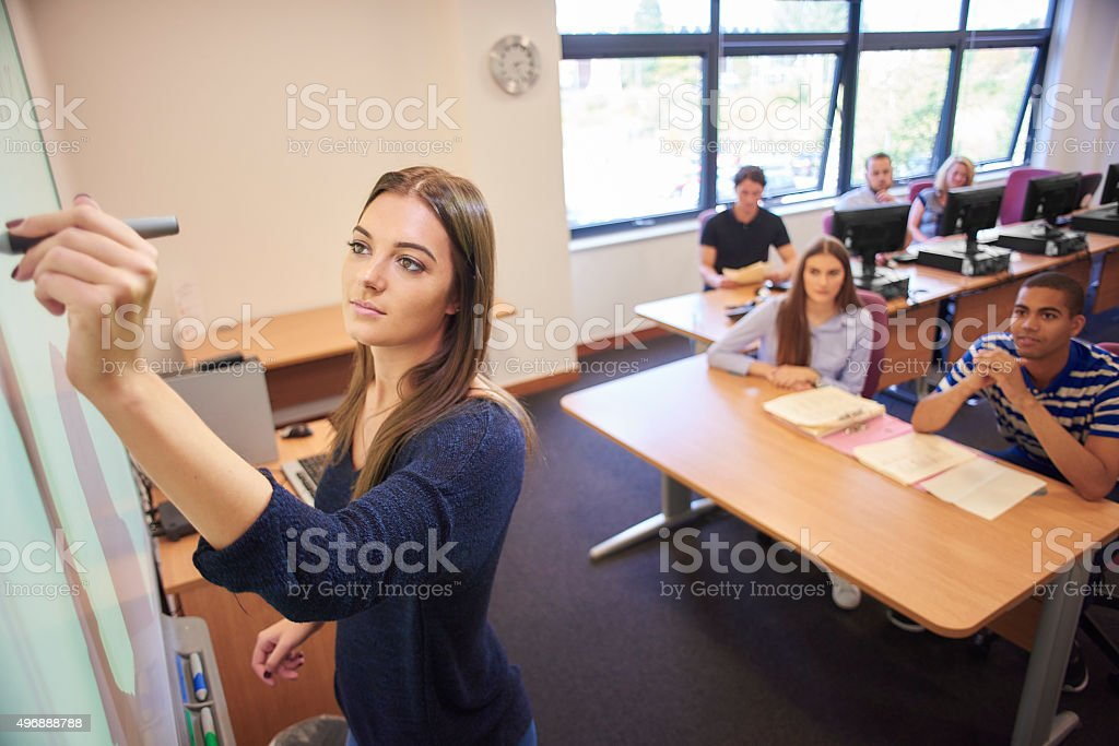 university student presenting to class stock photo