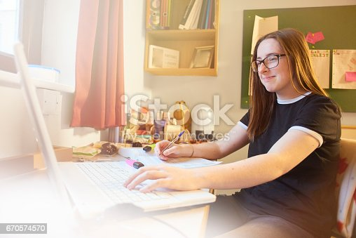 822557072 istock photo University student studying in her room on laptop 670574570