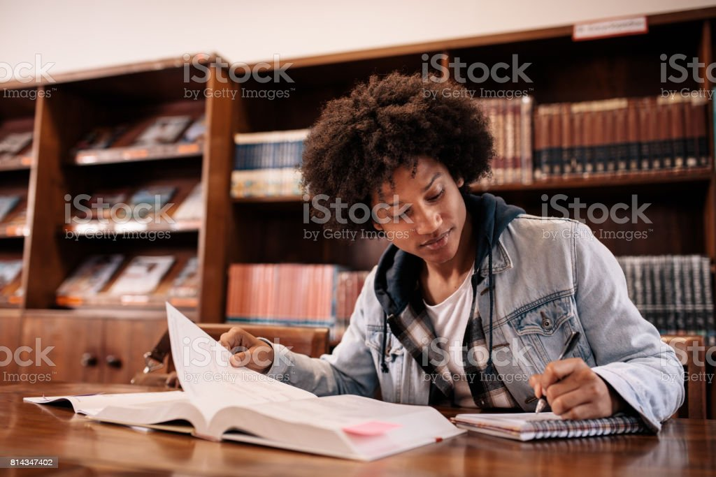 University student taking notes stock photo