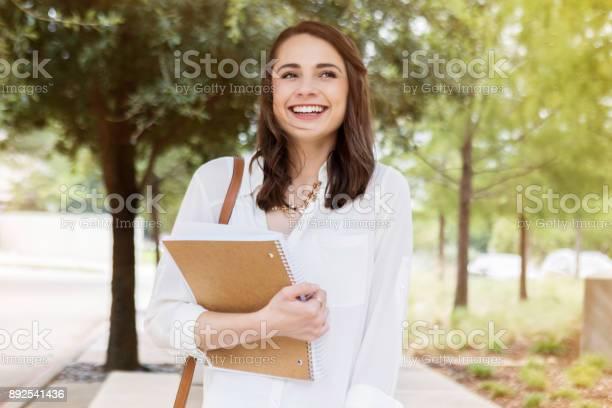 University student walks through campus to class picture id892541436?b=1&k=6&m=892541436&s=612x612&h= hd0o11poul07v97oy119ahvpw8t9f lsxgy36bzcds=