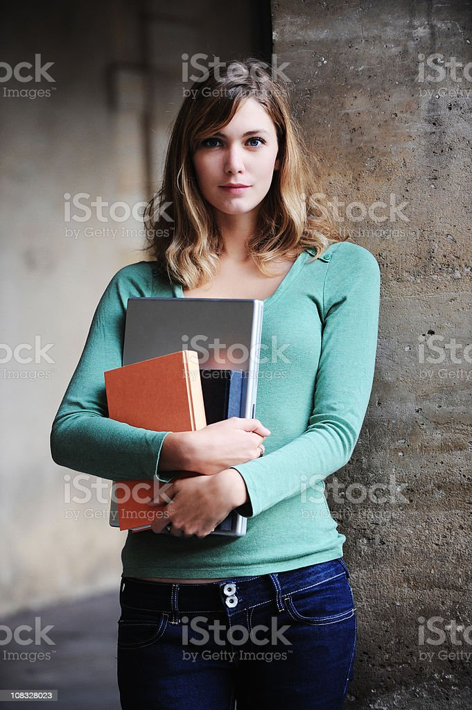 University Student Young Woman with Books and Laptop royalty-free stock photo