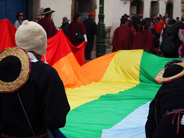 University Students Carry The Incan Flag In The Carnival